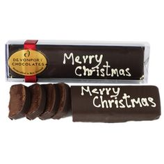 Merry Christmas Truffle Slice - (CMCLOG180_DEV)  A decadent dark chocolate truffle centre with Merry Christmas hand written in chocolate on top. Gluten Free All items are egg free except those with pavlova. Please allow up to 10 working days for the delivery of your order.