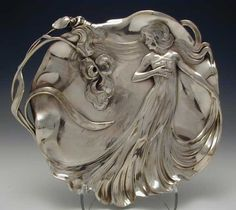 Polished pewter card tray with Art Nouveau maiden in flowing dress  Country of Manufacture Germany  Datecirca 1906