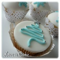 Christmas Cupcakes. Elegant, simple, with endless options. Easier yet, decorate bakery/store cookies with the same using a little while icing as the base.