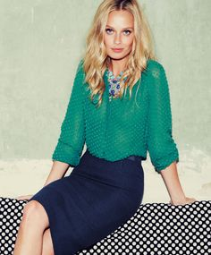 green top, navy pencil skirt