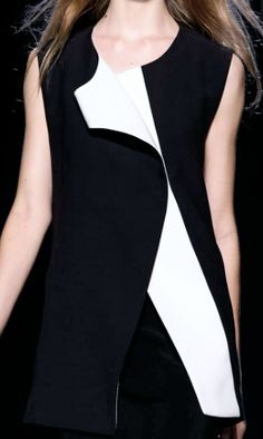 Black Vest with contrasting white trim; fashion details // Narciso Rodriguez Spring 2015