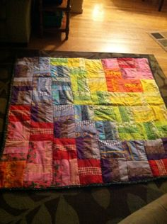 Baby quilt with rainbow rail fence squares