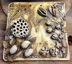 Tile - burn out with seed pods. Made by Tracy Dryden-Jones