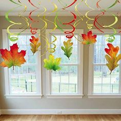 Add these festive Fall swirl leaves hanging from ceilings, doorways and more! Ea… Add these festive Fall swirl leaves hanging from ceilings, doorways and more! Each package contains six – leaf danglers and six green, gold and red twirls.