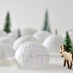 A Northern winter landscape as an advent calendar, lit by night, with elks and polar bears, including a starry sky. It's so easy to craft!