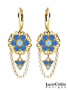 14K Yellow Gold Plated over .925 Sterling Silver Dangle Flower Earrings by Lucia Costin Ornate with Filigree Ornaments, Light Blue, Blue Swarovski Crystals and Lovely Charms; Handmade in USA Lucia Costin. $69.00. Unique jewelry handmade in USA. Lucia Costin flower shaped drop earrings. A perfect feminine touch. Mesmerizing enough to wear on special occasions, but durable enough to be worn daily. Crafted with aquamarine and sapphire Swarovski crystals