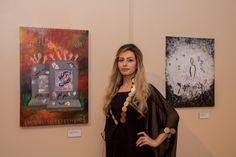 Artist Wurood Mahmood stands beside her pieces Photo credit: Mahmood Mahmood