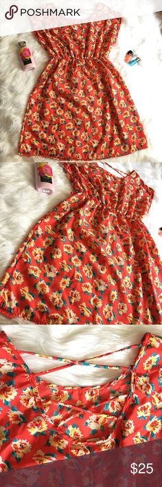 "Coral Floral Print Midi Dress W/ Criss Cross Back! Coral floral print midi dress with criss cross and scooped back. Includes elastic waist, loops for a belt, is also short sleeve. Length 35"". Bust Width 20"". Waist Width 13"". Body Central Dresses Midi"
