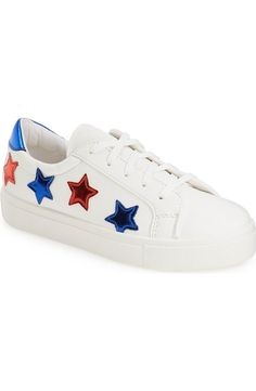 Stepping up the street-style game with these Italian sneakers featuring a crisp white platform and all-star look.
