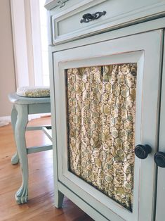 Chicken wire cabinet door with fabric                                                                                                                                                     More