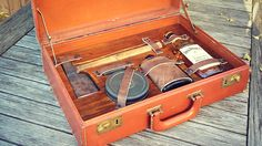 Gentleman's Survival Kit | Get an old briefcase, figure out what you want to carry, lay out the items on a sheet of plywood, then add padding underneath, leather straps on top, and voila! Instant cool...