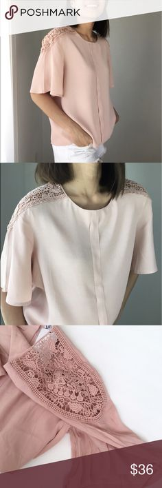 "Luxe lush blush crocheted top shoulder top Luxe lush blush basic chic. Crocheted top shoulder with button down back.flare sleeves. Made in USA. I am wearing size s for the cover shots.  Bust 34"", length 22"".  W:36"". 52%rayon 48%viscose.. CHICBOMB Tops Blouses"