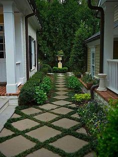 So pretty...but the plant material in between the concrete may not be worth the tripping hazard. Small gray or brown pebbles could be used to fill the spaces between squares.