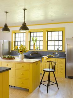 Bright yellow in morning light and mustard in the evening. So important to consider how the color changes in different lights throughout the day. -- Rafe Churchill, The New Farmhouse, Yellow Kitchen