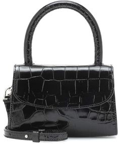 Indulge in nostalgia with the coveted Mini tote from cult label by FAR, seen here in a glossy black croc-effect iteration. The micro design has been crafted from leather and opens to reveal a compact suede-lined interior with . 90s Nostalgia, Color Names, Tote Handbags, Crocs, Dust Bag, Shoulder Strap, Designer Bags, Mini, 1980s