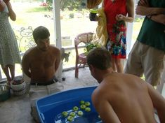 Bobbing for Nipples - Buckets of water with baby bottle nipples or pacifiers (or both). Set the clock for 2 minutes. Without using their hands, see how many nipples each person can recover before time is up. For a coed shower, put the men to the test with this game.