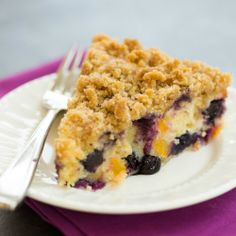 A dense, moist coffee cake loaded with blueberries and peaches, topped with a crunchy streusel.