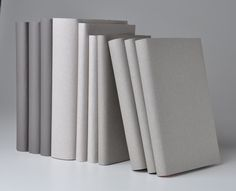 Paper wrapped books from Juniper Books; Custom Collections