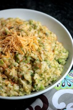 This Broccoli and Cheese Risotto is creamy and perfect with it's cheese and bits of broccoli! It's such a great comfort food and it's easy to make at home!