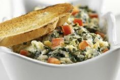 Baked Spinach Artichoke Yogurt Dip - Prep Time : 10 min; Ingred: 1 (14-oz) can artichoke hearts, drained and chopped; 1 (10-oz) package frozen chopped spinach, thawed and drained; 1 (8-oz) container plain yogurt; 1 c shredded part-skim, low-moisture Mozzarella cheese; ¼ c chopped green onion; 1 garlic clove, minced; 2 Tbl chopped red pepper (optional).  http://www.joyofkosher.com/recipes/baked-spinach-artichoke-yogurt-dip/