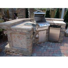 A Grill Island & Outdoor Kitchen with Attractive Built-Ins, Custom Stone & Tile