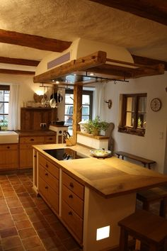 Rustic old wood beams above the kitchen island with wall-mounted extractor hood . Modern Farmhouse Kitchens, Rustic Kitchen, Country Kitchen, Home Kitchens, Extractor Hood, Extractor Fans, Cafe Interior, Interior Design Living Room, Wood Beams