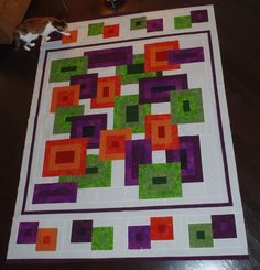 Turning a square quilt into a rectangle shape.