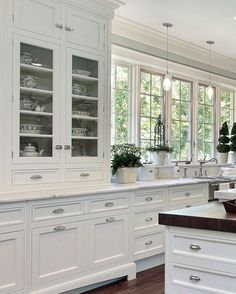 Green of kitchen wall w/white cabinets