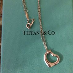 Tiffany Heart Necklace Beautiful sterling silver Tiffany necklace. THIS IS AUTHENTIC. Comes with the box and all the info card that came with it. Only worn a few times and I have no use for it anymore. Original price is $150, and I am a little negotiable. Make me an offer! Tiffany & Co. Accessories