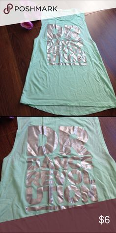 Dance Revolution mint tank Dance Revolution mint tank, small, EUC.    🛍NO HOLDS 🛍NO TRADES 🛍REASONABLE OFFERS CONSIDERED (if you offer 50% or more off my asking price that is insulting) 🛍All items are packaged with care and shipped out in 1 day 🛍Please leave me questions if you have any! Bella  Tops Tank Tops