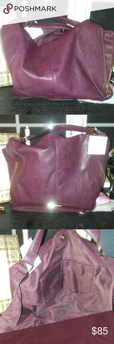 """NWT Liz Claiborne Pebbled Leather Maroon Bag This bag could be a regular size, or it could be huge! Liz has incorporated zippers on each side that add 6"""" width EACH! The front has 2 slanted zippered pockets as well as the normal zippered pocket inside & 2 pockets. It's a double handled strap making this a hand bag that breaks every rule of traditional hand bags! I love this bag! If it doesn't sell in a couple of weeks, I'M KEEPING IT! 16""""W x 12""""H x 4""""D add another 6"""" to both sides when extra…"""