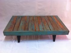 Handcrafted coffee table from reclaimed wood by Calico Studio. Painted, sanded, stained and varnished. Calicostudio12@gmail.com