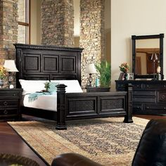 "From Stacy Furniture  ""Carmel Highlands"" it is burnished and distressed birch and cathedral walnut veneers and solids in a Vineyard Brown finish and Black Copper finish with rub-through.  Key elements include tooled leather, acid washed and brushed granite, hand-forged iron, and carved brass hardware in a dark patina finish with rub-through."
