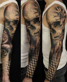 http://tattoomagz.com/full-arm-tattoos/skull-and-eye-full-arm-tattoo/