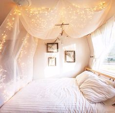 canopy + lights = good sleep + sweet dreams definitely want to do something like this in my room next year. Maybe for the room