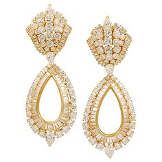 Van Cleef & Arpels Diamond Gold Earrings Pendant | From a unique collection of vintage dangle earrings at https://www.1stdibs.com/jewelry/earrings/dangle-earrings/