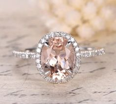 Solid 14k Rose Gold oval morganite and diamond Halo engagement ring Morganite: 1.8ctw 7x9mm Oval Cut Diamonds: 0.26ctw pave' Color: H Clarity: SI Size: please message your ring size at time of order