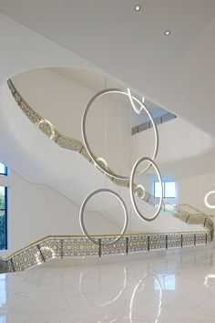 We love the beauty of the space, white, air, free, circles..