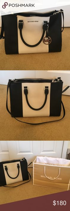 Michael Kors Black and White Bag Authentic Michael Kors bag retailed at $398 dollars, only used one season looks brand new. Comes with original dust bag and Michael Kors shopping bag Michael Kors Bags Satchels