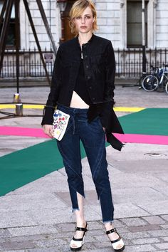 Edie Campbell in black crop top with Marques Almeida denim