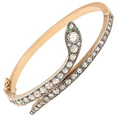 A Victorian Emerald Eyed Diamond Snake Bracelet  | From a unique collection of vintage bangles at https://www.1stdibs.com/jewelry/bracelets/bangles/