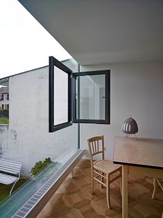 A Simply Glass Window With Transparant Wall For Dining Area With Brown Patterned Flooring And Classic Dining Table With Amusing Table Decor As A Small Extension Becomes the Most Interesting Part of the House Home design http://seekayem.com