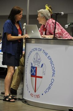 Diocese of Fort Worth Deputy Katie Sherrod, right, and another deputy consult July 11 as Sherrod prepares to comment on the proposed 2013-2015 budget during the House of Deputies' committee of the whole session prior to formal debate. ENS photo/Mary Frances Schjonberg #episcopal #general-convention #budget #gc77 #deputies #deputy