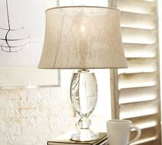 "Lexington Crystal Table Lamp Base   ""True crystal has a clarity and brilliance that can't be replicated. Our Lexington lamp base's clear cord runs directly from the switch to the outlet for a clean look.  5"" diameter, 23"" high Fittings have a polished-nickel finish. Dimmer switch on socket. Pair with our medium Natural Fiber Drum Shade (shown) or any of our medium Mix  Match® shades (all shades sold separately)."""