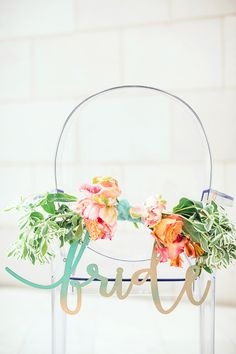 floral chair decor with sign - photo by Izzy Hudgins http://ruffledblog.com/inspiring-summer-wedding-looks