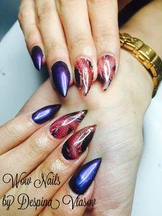 Dragon tattoo on stiletto nails