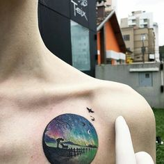 THIS ARTIST, @evakrbdk IS QUICKLY BECOMING ONE OF MY FAVORITES. HE KNOWN FOR SMALL ILLUSTRATIVE TATTOOS LIKE THIS LANDSCAPE WITH THE NORTHERN LIGHTS. ・・・ nice to be in Brasil