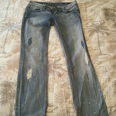 Jeans Lighter Blue faded wash with holes on legs. Worn a few times perfect condition selling due to not fitting. Length is 31.5 Express Jeans