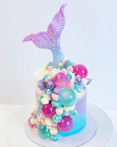 How amazing is this buttercream mermaid tail cake by It's an unique twist for a mermaid cake that usually are adorned with… Dolphin Birthday Cakes, Dolphin Cakes, Mermaid Birthday Cakes, Mermaid Cupcake Cake, Little Mermaid Cakes, Cupcake Cakes, Mermaid Tail Cake, Sirenita Cake, Bolo Barbie