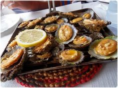 Lapas Grelhadas dos Açores. These are huge limpets grilled and served in their own shells. I have eaten these in Madeira. Yum.